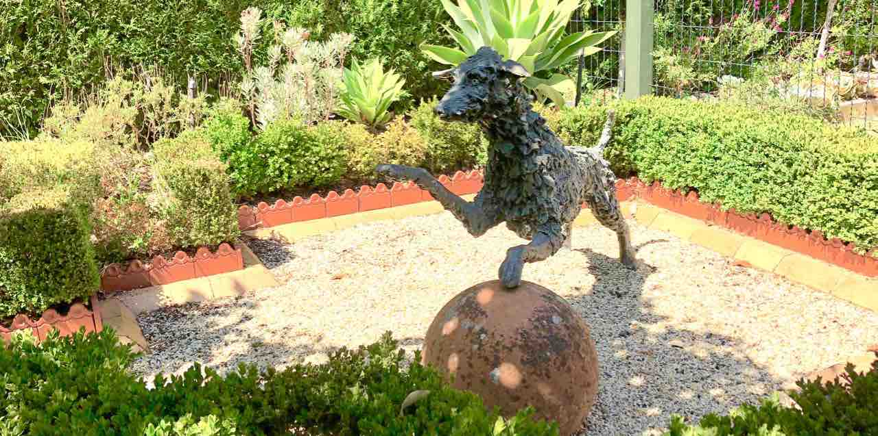 Sensory garden dog and ball sculpture